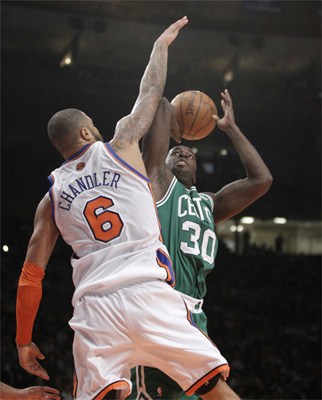 New York Knicks center Tyson Chandler (6) defended as Boston Celtics forward Brandon Bass (30) looked to score during the second half.