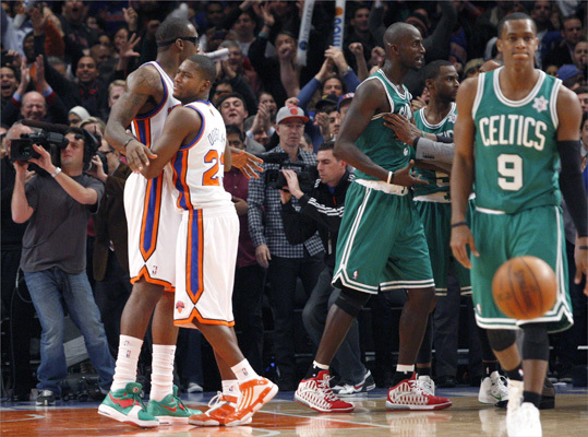 New York Knicks Toney Douglas (second left) and Amar'e Stoudemire (left) celebrated as Boston Celtics Kevin Garnett (second right) and Rajon Rondo left the floor after the Knicks defeated the Celtics.