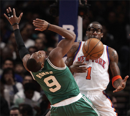 New York Knicks forward Amare Stoudemire (1) watched as Boston Celtics point guard Rajon Rondo (9) lost control of the ball after a Knicks defender knocked it loose.