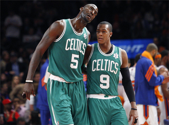 Boston Celtics' Kevin Garnett (left) talked with teammate Rajon Rondo during a time out in the second half.