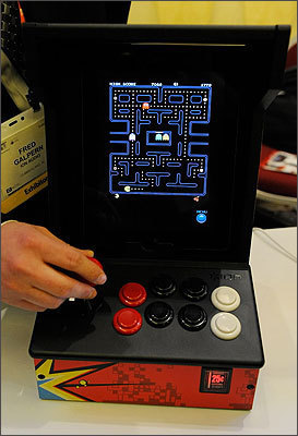 On an iCade, users can play video games on their iPad. More than 250 games are available. It's on sale for $100 and comes with a retro wooden cabinet to hold the iPad.