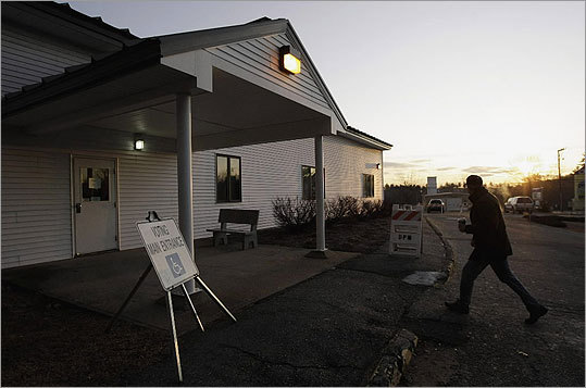 A voter walked into a polling location to vote during sunrise at the St. James United Methodist Church in Merrimack.