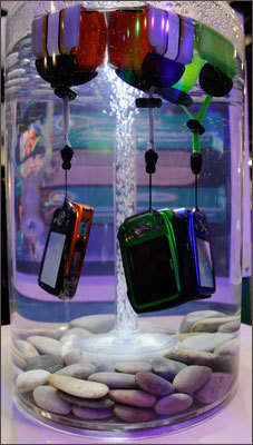 Fujifilm FinePix digital cameras were displayed in water to demonstrate that they are waterproof (up to to 32.8 feet) at CES on Tuesday.