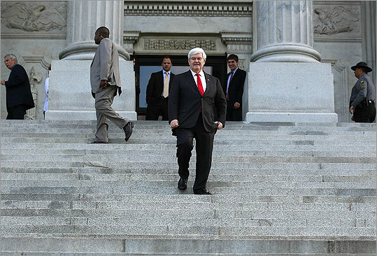 Newt Gingrich walked down the steps of the State Capitol building before speaking to supporters attending the rally for home ownership.