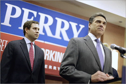 During a news conference Jan. 19 in North Charleston, S.C., Rick Perry announced that he was suspending his campaign and endorsing Newt Gingrich. His son Griffin is at left.