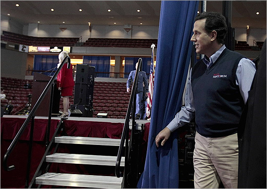 Rick Santorum peered out from behind a curtain before speaking to the Southern Republican Leadership Conference on Jan. 19 in Charleston, S.C.