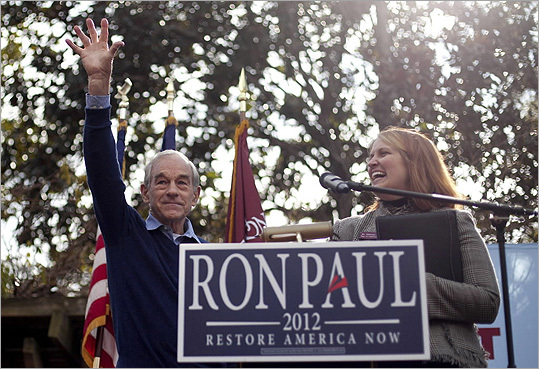 Ron Paul acknowledged the crowds after speaking at the College of Charleston in Charleston, S.C., on Jan. 19. Also on stage is Amanda Ruth-McSwain, associate professor and director of The Bully Pulpit Series.