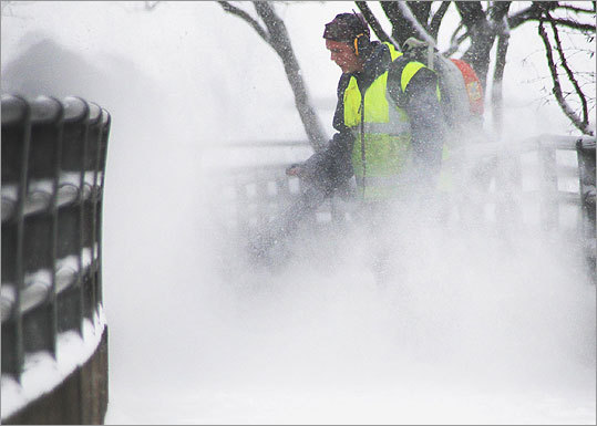DCR worker Keith Donnelly used a leaf blower to clear the Charles Street Footbridge in Boston.