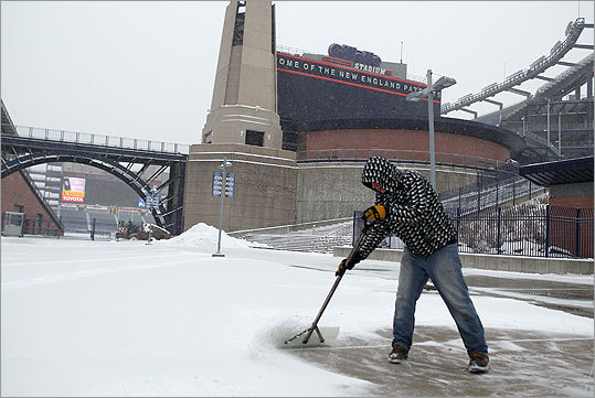 Mike King worked to remove some of the snow from Gillette Stadium for the upcoming AFC Championship game.