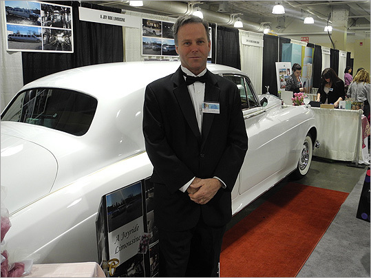 Sean O'Sullivan of ALimo4-U, based in Braintree, posed with one of his cars.