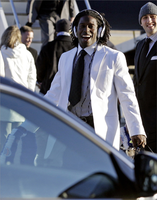Patriots wide receiver Deion Branch smiled as the team arrived in Indianapolis.