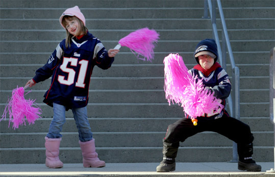 Patriots fans Madison and Shawn Murray of Rhode Island danced at Gillette Stadium before the rally.