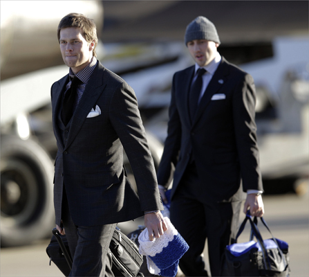 New England Patriots quarterback Tom Brady walked off the plane as the team arrived.