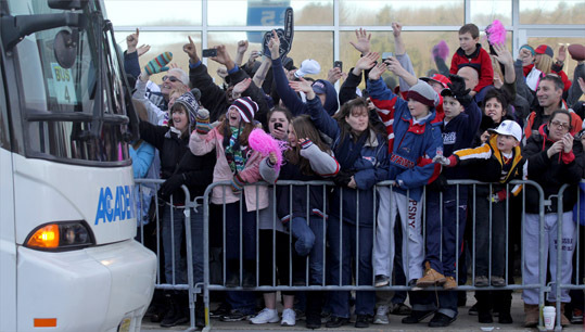 New England Patriot fans waved to the departing buses.