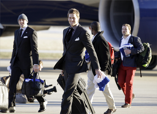 New England Patriots quarterback Tom Brady smiled as the team arrived at the Indianapolis International Airport.