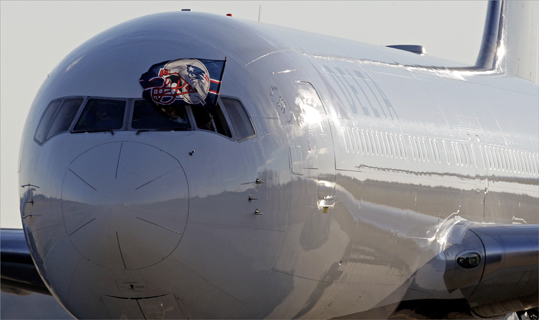 A New England Patriots flag was displayed out window of the team's charter plane.