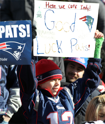 Kyle Maker, 12, from Halifax, Mass., held up a sign supporting the New England Patriots during a sendoff rally at Gillette Stadium.