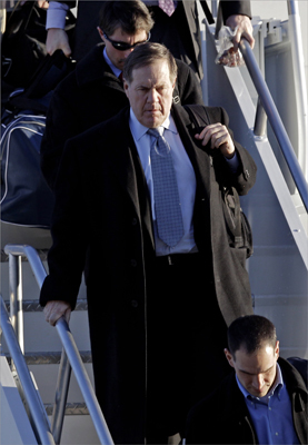 New England Patriots head coach Bill Belichick walked off the plane as the team arrived in Indianapolis.