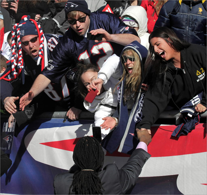 New England Patriot fans reacted to players at Gillette Stadium during the Super Bowl sendoff rally.