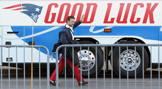 Wide receiver Wes Welker headed for the bus.