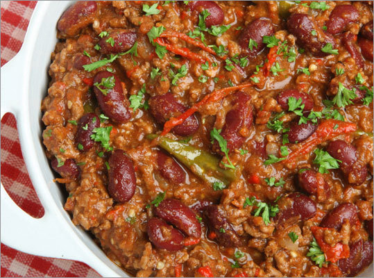 """Chill out with a pot of chili While you are watching the pre-pre-game show, which starts around noon, (the pre-game show starts around 3 p.m.), huddle together the ingredients for chili in the crockpot. What makes chili a super food? The beans. A ½ cup of cooked beans provides 10 percent or more of the recommended daily value for potassium and magnesium, nutrients that can help lower blood pressure. The soluble fiber in beans can help lower the """"bad"""" LDL cholesterol in the body. Both high blood pressure and blood cholesterol increase the risk of heart disease – the number one cause of death among Americans. Joan's Tip: For a guaranteed chili to please your guests, try this easy-to-make recipe."""
