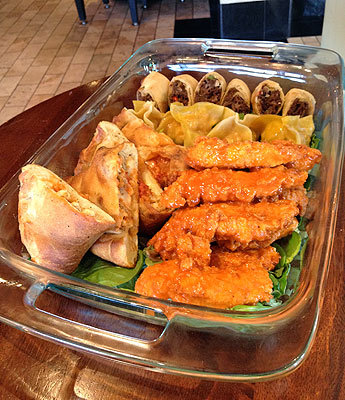 Brady's Bites Andiamo 100 City Square, Charlestown A greasy no-forks-necessary appetizer sampler dreamed up by the crew at Andiamo after the Pats' quarterback once told American Way magazine , 'When you hang with a bunch of 300-pound linemen, you tend to find the places that are the greasiest and serve the most food.' The platter includes your pick of four items with choices like chicken tenders, prosciutto arencini, shrimp dumplings, and steak and cheese spring rolls.