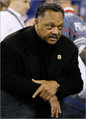 Jesse Jackson watched as the teams warmed up.