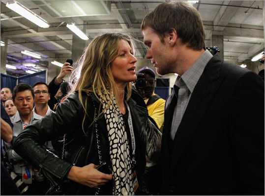 Patriots QB Tom Brady chatted with wife Gisele Bundchen after losing to the New York Giants by a score of 21-17 in Super Bowl XLVI at Lucas Oil Stadium.