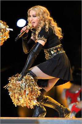 Madonna even sported a pair of gold pom poms during the poppy cheer of 'Luvin.' '