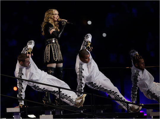 Madonna's show included high-wire stunts, along with classic Madonna dance moves.