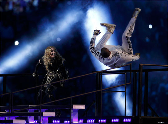 Madonna looked on as one of the dancers flipped out.