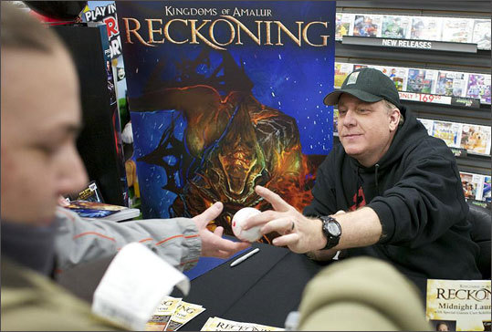Curt Schilling met with fans at Game Stop in Bellingham during the release of the game at midnight. The game is a fantasy role-playing game. Players control custom-made characters with special powers and weapons, and send them on quests to steal treasure and battle monsters.
