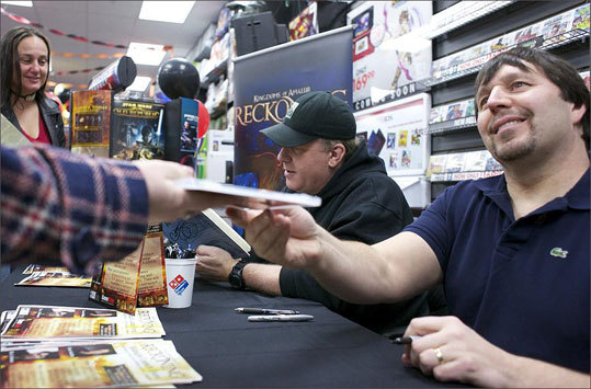 Schilling, center, and R.A. Salvatore, right, greeted and signed for fans. Salvatore is a best-selling author from Massachusetts who also writes video game stories.