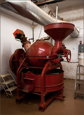 Roasting For the first step in Somerville, the cacao beans are roasted in a 100 kilo capacity cacao roaster. Taza employees found the mid-century German machine in disrepair in Italy. Taza had it refurbished and shipped the roaster to Massachusetts.