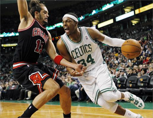 Boston Celtics' Paul Pierce (34) drove past Chicago Bulls' Joakim Noah (13) in the first quarter.