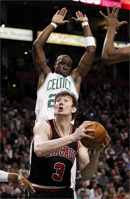 Celtics guard Mickael Pietrus (28) timed his jump to block a shot attempt by Bulls center Omer Asik (3).