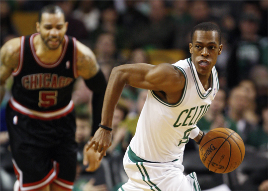 Boston Celtics Rajon Rondo (right) drove past Chicago Bulls Carlos Boozer in the second half. Rondo had 32 points, 10 rebounds, and 15 assists in the game. The Celtics broke a two-game losing streak with the 95-91 win.