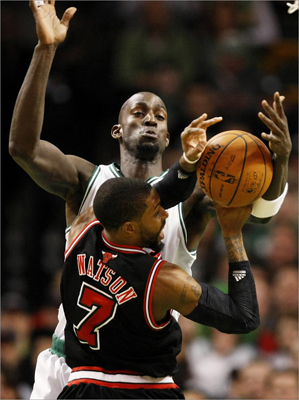 Celtics forward Kevin Garnett blocked a shot attempt by Bulls guard C.J. Watson in the first quarter.