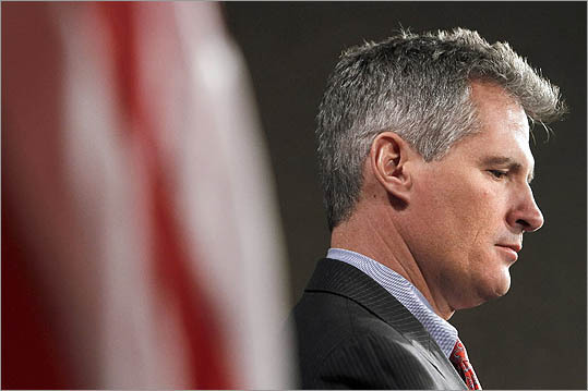 Sen. Scott Brown, R-Mass. listened during a news conference on Capitol Hill in Washington on Jan. 31, to discuss the Stop Trading on Congressional Knowledge Act, or STOCK.