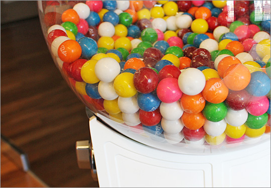 A close-up on the logo-printed gumballs found in the office's lobby.