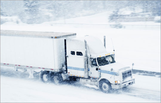 Truck drivers are required to clear snow off the top of their trailers, and can face jail time if flying ice or snow injures a motorist. True or false?