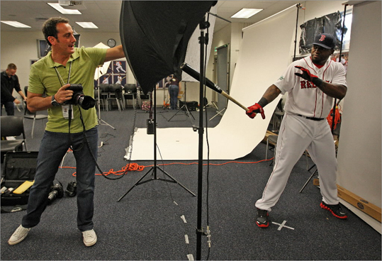 Sunday was the annual 'Picture Day' at spring training, when Red Sox players dressed in their home white uniforms and posed for photos to be used in publications, on the scoreboard at Fenway Park, baseball cards, and more. They also did videos and taped promotional radio spots. Here, a photographer shows Red Sox designated hitter David Ortiz how he wants him to pose. Scroll through the gallery to see more scenes from picture day.