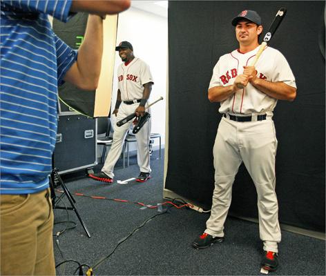 Adrian Gonzalez was already posing when David Ortiz strolled by.