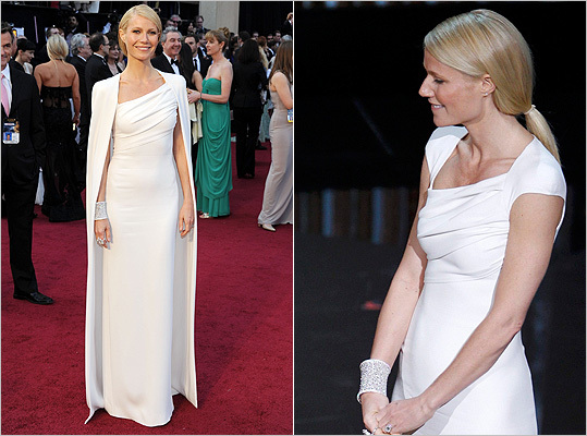 HIT -- Gwyneth Paltrow We've always thought of Paltrow as a bit of a Wonder Woman. In fact, there should have been a category added to this year's Oscars specifically for her: Best Seizure as a Result of a Virus. Paltrow dazzled with her sartorial choice at last night's awards. Her beautifully fitted Tom Ford ivory evening column with cape was a modern take on elegance.