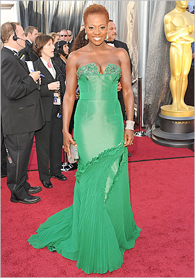 MISS -- VIOLA DAVIS Kudos on the natural hair. The dress is another matter. This tortured and over-worked Vera Wang gown looks like an angry shamrock attacked Davis on the carpet.