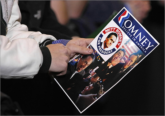 A supporter held a Romney For President card while waiting for Romney to hold a gathering at Surburban Collection Showcase in Novi.