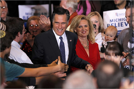 Mitt Romney narrowly won the Michigan GOP primary and had a strong win in Arizona, staving off a challenge from former US senator Rick Santorum over who would win Michigan. Take a look at scenes from the two states. Pictured: Romney shook hands with supporters as he arrived with his wife Ann to speak at his Michigan primary night rally in Novi, Mich. Read more