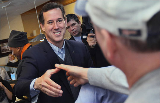Rick Santorum greeted diners at the Rainbow Grill in Grandville.