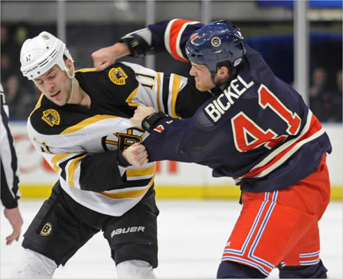 New York Rangers' Stu Bickel, right, fought with Boston Bruins' Gregory Campbell during the first period at Madison Square Garden in New York.