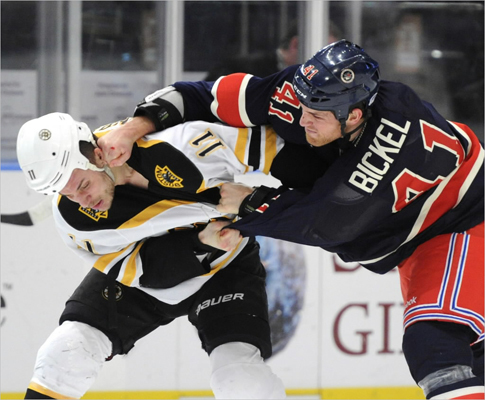 Boston Bruins center Gregory Campbell and New York Rangers defenseman Stu Bickel (41) fought in the first period.